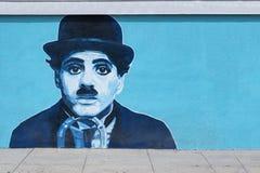 Граффити настенной росписи Чарли Чаплина на стене Стоковое фото RF