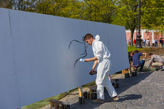 Граффити на белой стене Стоковые Фотографии RF