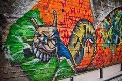 Граффити неопознанного художника на стене Стоковая Фотография