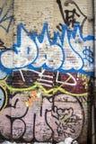 Граффити пишет или чертежи на стене Стоковая Фотография RF
