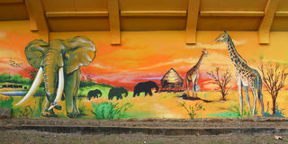 Граффити представляя африканский ландшафт стоковые фото