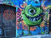 Граффити с извергом и львом Стоковое Изображение