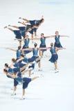 Грациозности команды катаясь на коньках выполняют Стоковые Изображения RF