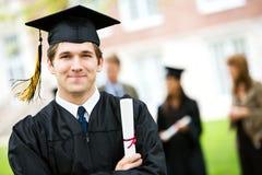 Градация: Жизнерадостный студент-выпускник с дипломом Стоковые Изображения RF