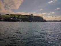 Гребень ветров Gijón увиденных от моря стоковое фото