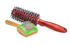 Гребень для котов на предпосылке щеток волос Стоковое фото RF