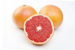 Грейпфруты на белой предпосылке Стоковое фото RF