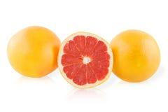2 грейпфрут и кусок грейпфрута Стоковая Фотография