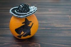 Грейпфрут с покрашенным силуэтом ведьмы Стоковая Фотография