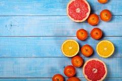 Грейпфрут, яблоки, апельсины и tanger крупного плана предпосылки плодоовощ Стоковая Фотография RF