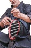 Грех ` bogu ` защитного оборудования носки Swordsman и ` шпаги бамбука стоковое изображение rf