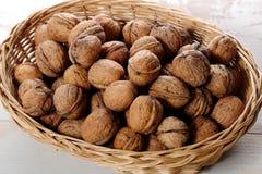 Грецкие орехи в малой плетеной корзине Стоковые Фотографии RF
