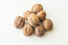 Грецкие орехи в раковине на белой предпосылке Стоковые Изображения RF