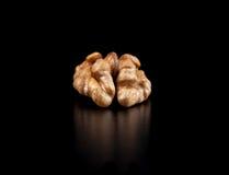 Грецкие орехи изолированные на черной предпосылке Стоковая Фотография RF