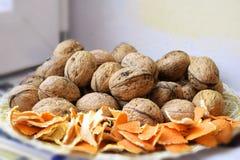 Грецкие орехи и апельсиновая корка Стоковые Изображения