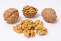 Грецкие орехи и стержени грецкого ореха на белой предпосылке Стоковые Изображения RF