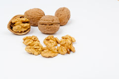Грецкие орехи и стержени грецкого ореха на белой предпосылке Стоковые Фото