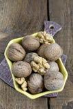 Грецкие орехи на деревянной предпосылке Стоковая Фотография