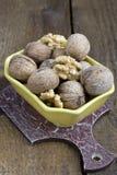 Грецкие орехи на деревянной предпосылке Стоковые Изображения