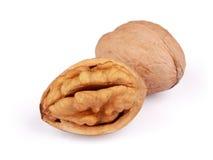Грецкий орех и треснутый грецкий орех изолированные на белизне Стоковое Фото