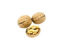 Грецкий орех и треснутый грецкий орех изолированный на белизне Стоковое Изображение