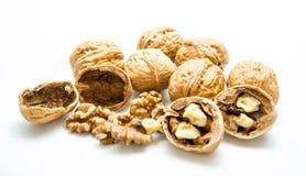 Грецкий орех и треснутый грецкий орех на белой предпосылке Стоковые Фото