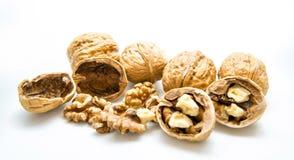 Грецкий орех и треснутый грецкий орех на белой предпосылке Стоковое Изображение