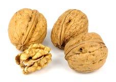 Грецкий орех и треснутый грецкий орех на белой предпосылке Стоковое Изображение RF