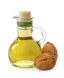 грецкий орех масла бутылки Стоковые Фотографии RF