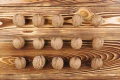 Грецкий орех на деревянной предпосылке Стоковые Изображения RF