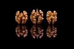 3 грецкого ореха на черной предпосылке Стоковые Изображения RF
