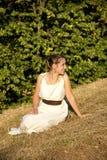 Греческая девушка на сене Стоковые Изображения