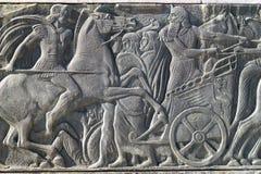 Греческая старая похожая металлическая пластинка на большом памятнике Александра, Греции Стоковые Изображения