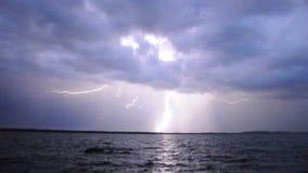 Гроза и молния над озером в ночи видеоматериал