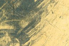 Грубая желтая предпосылка с пятнами, заплатами краски Стоковые Фотографии RF