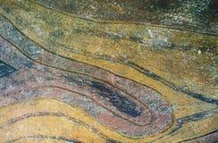 Грубая каменная предпосылка с искусственной текстурой Желтая и зеленая деревенская конкретная предпосылка Стоковые Изображения RF