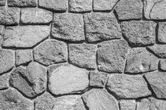 Грубая серая каменная стена, текстура предпосылки Стоковое фото RF