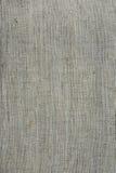Грубая текстура ткани linen холста, сплетенная предпосылка, обои, тоны света - серые и бежевые Стоковые Изображения