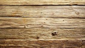 Грубая текстурированная выдержанная деревянная предпосылка стоковые фото