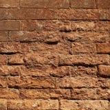 Грубая текстурированная кирпичная стена глины Стоковая Фотография RF