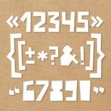 Грубые номера и символы отрезали из бумаги на картоне Стоковые Фотографии RF