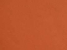 Грубые простые оранжевые предпосылка/текстура бетонной стены Стоковая Фотография RF