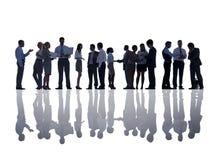 Группа в составе бизнесмены встречать Стоковые Изображения RF