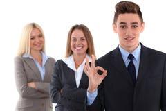Группа в составе бизнесмены, одобренный знак руки стоковые фотографии rf