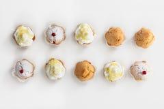 Группа в составе вкусные булочки изолированные на белизне Стоковая Фотография RF