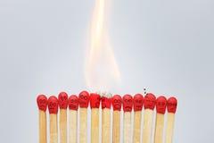 Группа в составе гореть эмоциональные спички Стоковое Изображение RF
