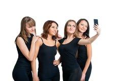 Группа в составе девушки делая selfi изолированная на белизне Стоковое Фото