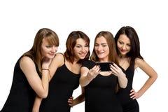 Группа в составе девушки делая selfi изолированная на белизне Стоковые Изображения