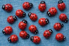 Группа в составе деревянные ladybugs Стоковое Фото