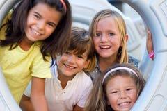 Группа в составе дети имея потеху в парке Стоковое фото RF